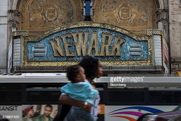 A pedestrian walks in front of the Paramount Theater which has been closed since 1986 on Market Street in Newark New Jersey US on Wednesday March 9...