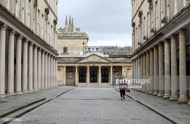 Pedestrian walks in the city centre of Bath, southwest England, on March 12, 2021. - From March 15, drivers of polluting vehicles must pay a daily...
