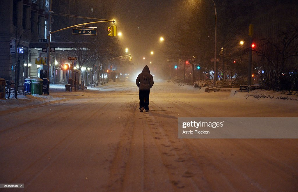 A pedestrian walks in the snow on Broadway at West 81st street on January 23, 2016 in New York City. A major Nor'easter is hitting much of the East Coast as forecasts warn of snow falling to well over a foot in some areas.
