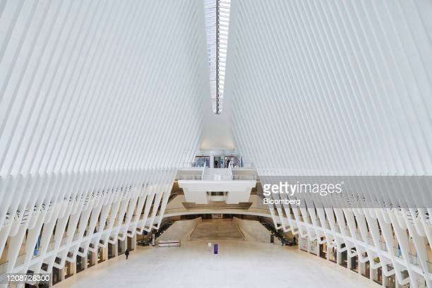 A pedestrian walks inside a nearly empty Oculus transportation hub in the Financial District of New York US on Monday March 30 2020 Roughly 37500...
