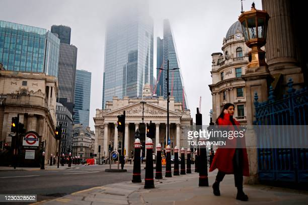 Pedestrian walks near the Royal Exchange and the Bank of England in the City of London on the bank holiday, December 28 as Londoners continue to live...