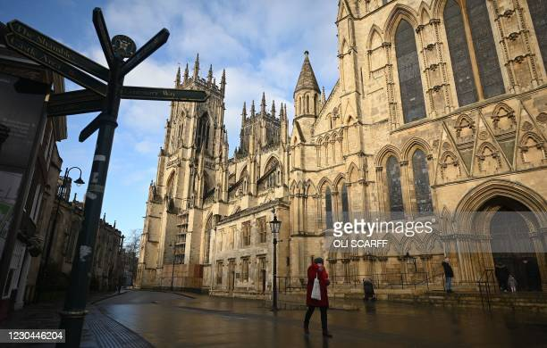 Pedestrian walks on a deserted street outside York Minster in York, north west England on January 6 on the second day of Britain's national lockdown...