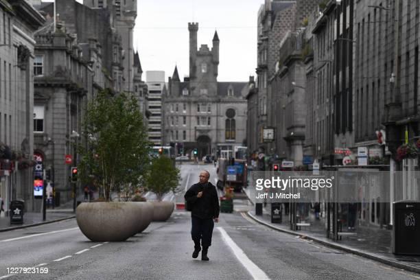 Pedestrian walks on an empty street on August 5, 2020 in Aberdeen, Scotland. Scotland's First Minister Nicola Sturgeon acted swiftly and put Aberdeen...