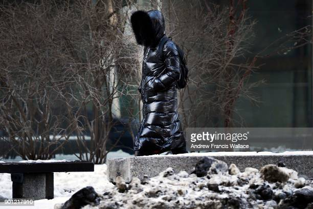 TORONTO ON JANUARY 4 A pedestrian walks on Bay St near Toronto City Hall January 4 2018 Environment Canada issued a weather statement Wednesday...