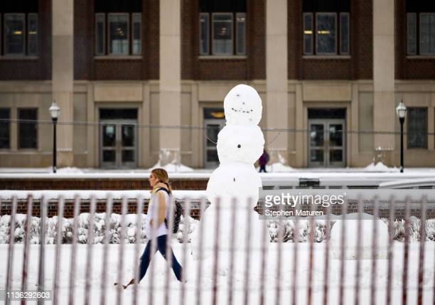 A pedestrian walks on the University of Minnesota campus on April 11 2019 in Minneapolis Minnesota The week in Minnesota started with two sunny...