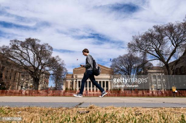 A pedestrian walks on the University of Minnesota campus on April 9 2019 in Minneapolis Minnesota The week in Minnesota started with two sunny Spring...