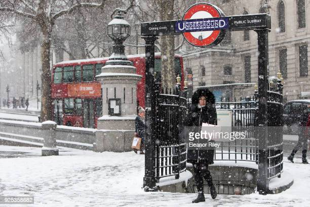 A pedestrian walks out of the Charing Cross underground station in Trafalgar Square during a snow flurry on February 28 2018 in London United Kingdom...