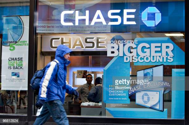 A pedestrian walks outside a JPMorgan Chase Co consumer bank branch in New York US on Wednesday Dec 30 2009 US banks have tapped the Federal Reserve...