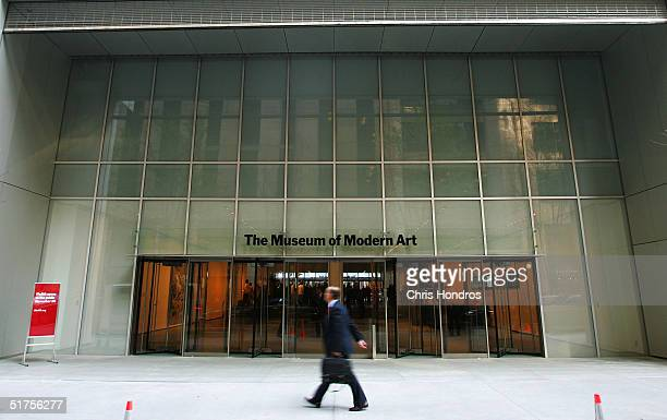Pedestrian walks outside the entrance to the new Museum of Modern Art building on 53rd Street November 17, 2004 in New York City. The new Yoshio...