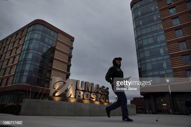 A pedestrian walks outside the new dorms at UMass Boston on Nov 9 2018 The freshmen who moved into UMass Bostons firstever dormitory on Labor Day...