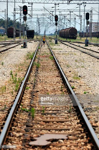 A pedestrian walks over rail tracks near the central railway station in Podgorica Montenegro on Saturday June 2015 Montenegrin Finance Minister...