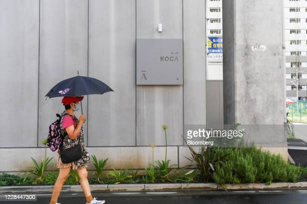 Pedestrian walks passes the entrance of the Koca co-working space built under railway tracks in Tokyo, Japan, on Thursday, Sept. 3, 2020. In Tokyo,...