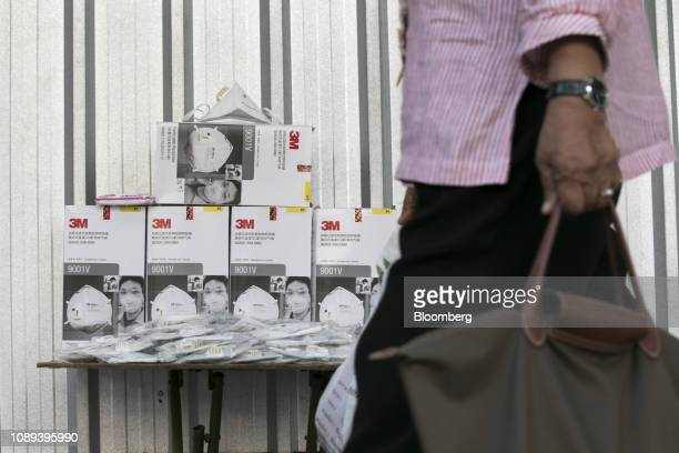 A pedestrian walks past 3M Co masks displayed for sale in Bangkok Thailand on Friday Jan 25 2019 Outpatient visits at Ladprao General Hospital Pcl...