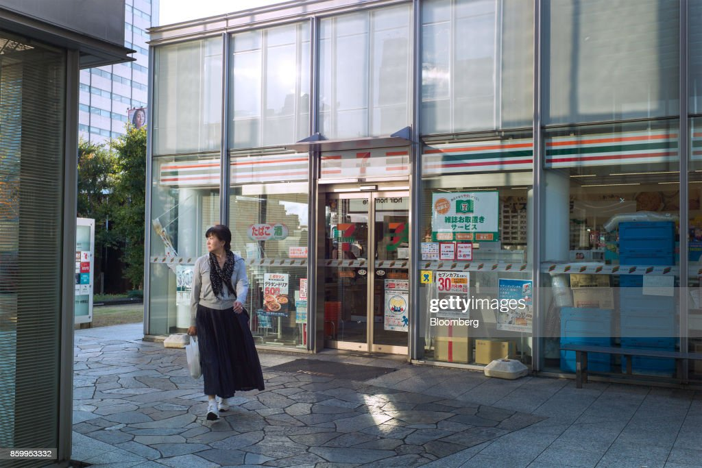 A pedestrian walks past a 7-Eleven convenience store, operated by Seven & i Holdings Co., in Tokyo, Japan, on Monday, Oct. 9, 2017. Seven & i is scheduled to report its second-quarter earnings results on Oct. 12. Photographer: Kentaro Takahashi/Bloomberg via Getty Images