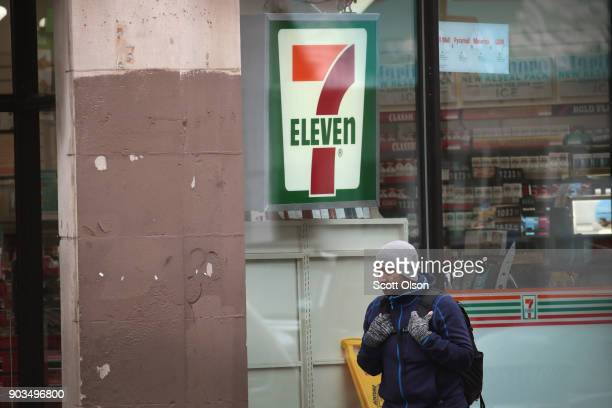 A pedestrian walks past a 7Eleven store on January 10 2018 in Chicago Illinois Immigration officials raided nearly 100 7Eleven stores across the...