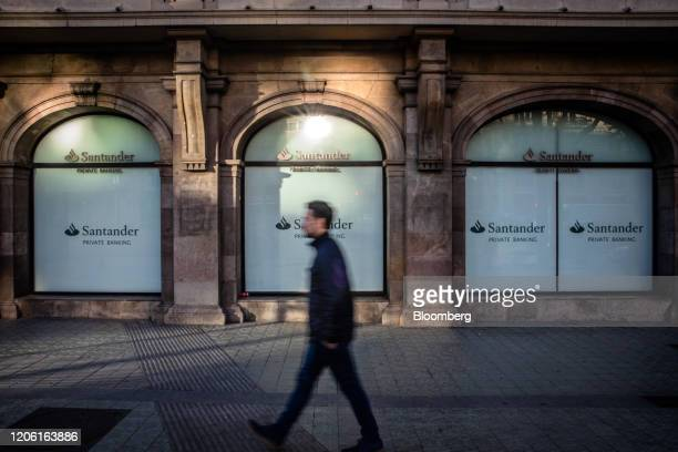 A pedestrian walks past a Banco Santander SA private banking branch in Barcelona Spain on Friday March 6 2020 Spanish bank shares soared after the...