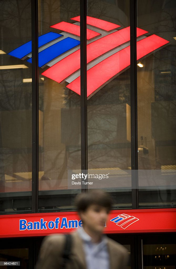 A pedestrian walks past a Bank of America building on February 4, 2010 in Charlotte, North Carolina. Bank of America's former Chief Executive Officer Ken Lewis and former Chief Financial Officer Joe Price have been charged with securities fraud by the New York attorney general.