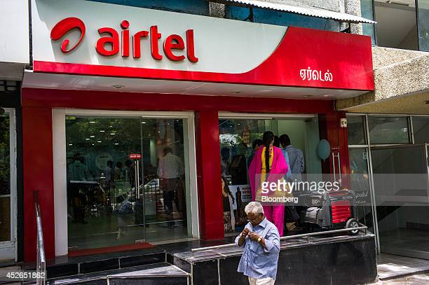 A pedestrian walks past a Bharti Airtel Ltd store in Chennai Tamil Nadu India on Monday July 21 2014 Optimism about a revival in Asias thirdlargest...