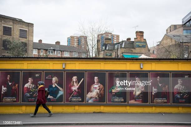 A pedestrian walks past a billboard advertising the Television program SEX Education on St Thomas Street on February 4 2020 in London England