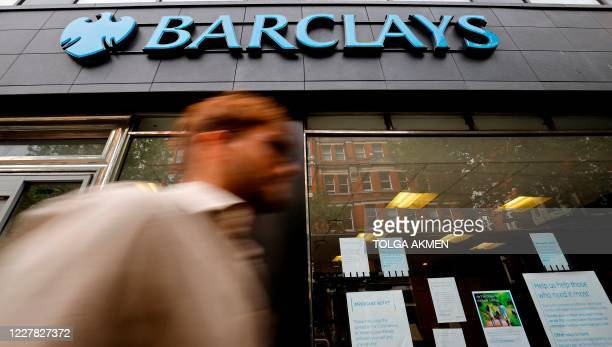A pedestrian walks past a branch of a Barclays bank in central London on July 29 2020 British bank Barclays said Wednesday that firsthalf net profits...