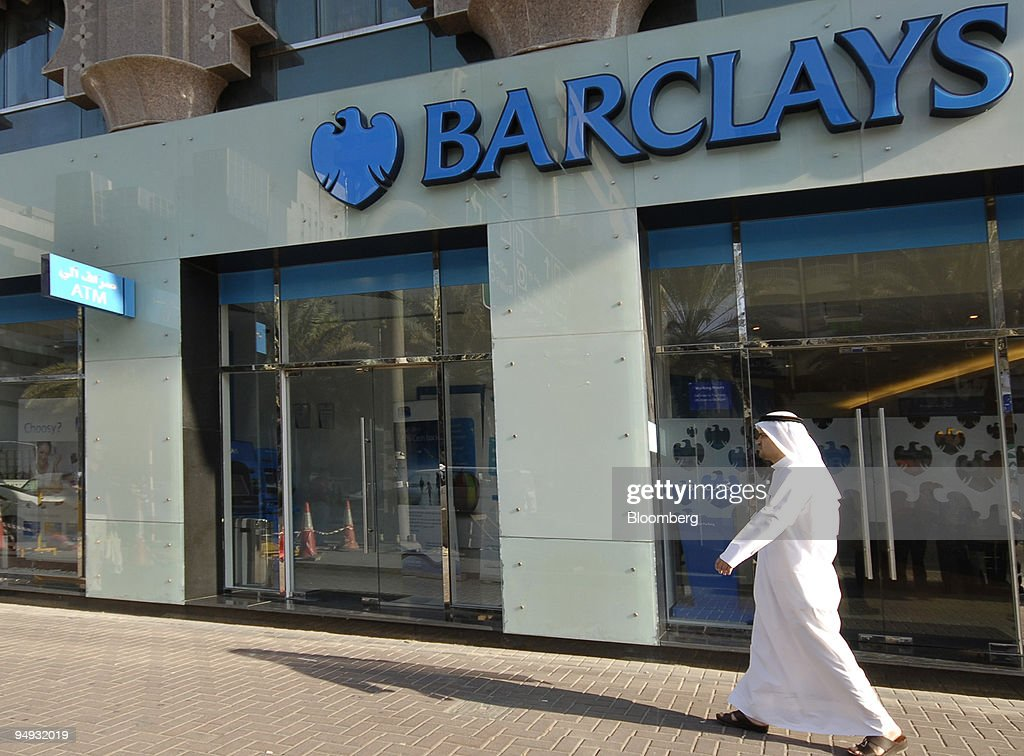 A pedestrian walks past a branch of Barclays bank in Dubai, United Arab Emirates, on Monday, Nov. 17, 2008. Barclays Plc, the U.K.'s second-biggest bank, offered institutional investors as much as 500 million pounds ($750 million) of stock reserved for Persian Gulf funds and said management will stand for re-election next year.