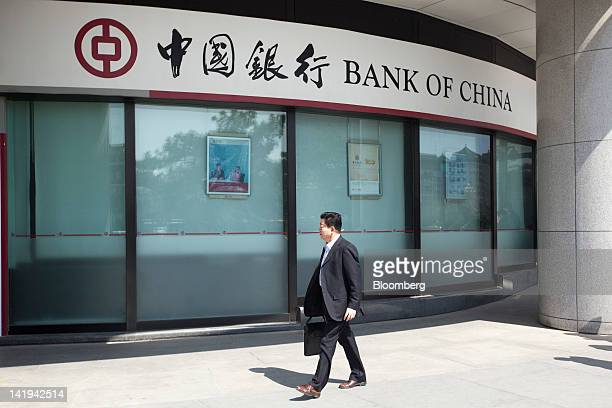 A pedestrian walks past a branch of the Bank of China Ltd in Beijing China on Tuesday March 27 2012 Bank of China is expected to announce earnings on...