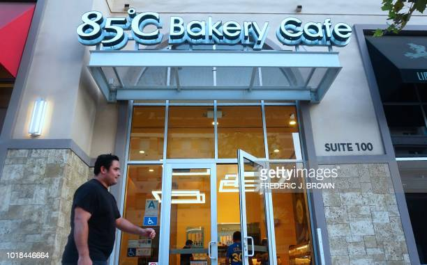A pedestrian walks past a branch of the Taiwan bakery chain 85 Degrees Celsius in the Los Angeles County city of Alhambra California on August 17...