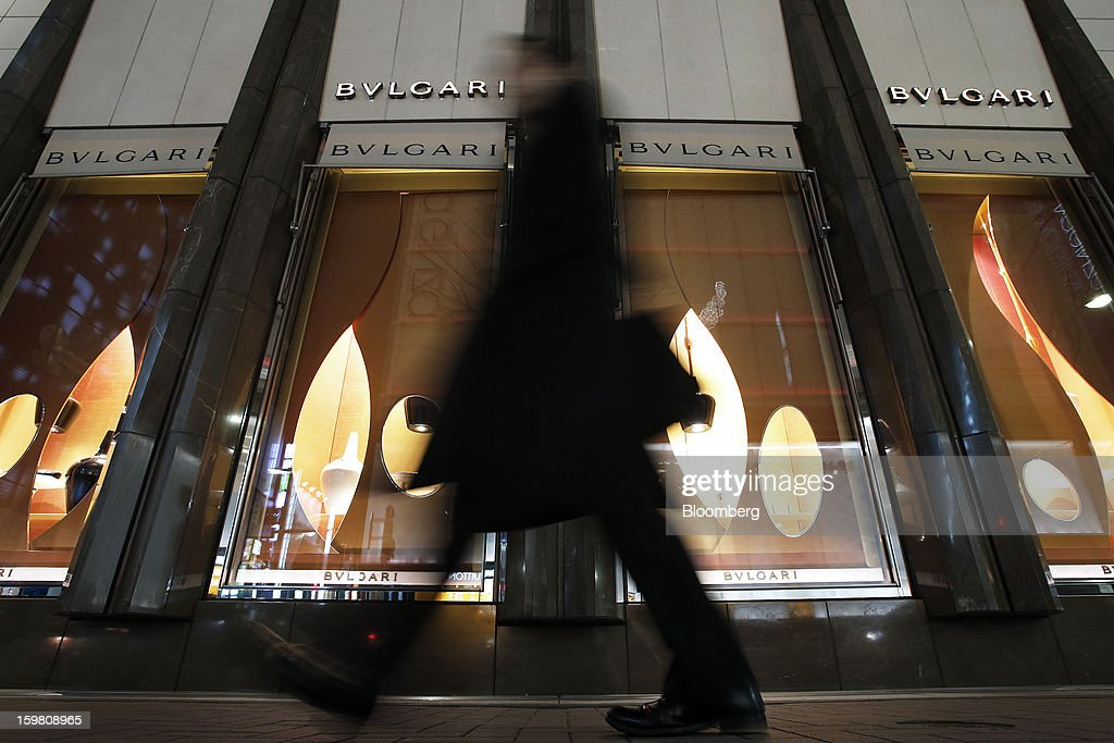 A pedestrian walks past a Bulgari SpA store, a luxury unit of LVMH Moet Hennessy Louis Vuitton SA, in the Ginza district of Tokyo, Japan, on Sunday, Jan. 20, 2013. Japan's consumer prices excluding fresh food, a benchmark monitored by the central bank, haven't advanced 2 percent for any year since 1997, when a national sales tax was increased. Photographer: Kiyoshi Ota/Bloomberg via Getty Images
