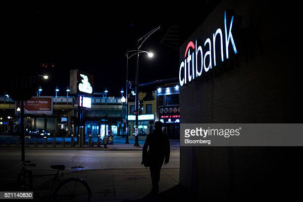 A pedestrian walks past a Citigroup Inc Citibank branch at night in Chicago Illinois US on Monday April 11 2016 Citigroup Inc is scheduled to release...