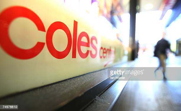 A pedestrian walks past a Coles supermarket after the announcement of Wesfarmers takeover bid July 2 2007 in Sydney Australia The deal recommended by...