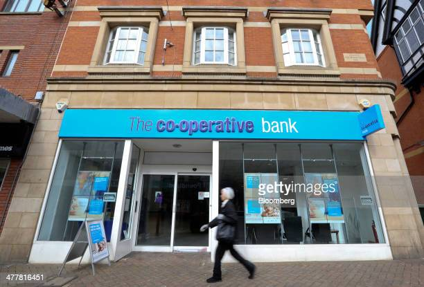 A pedestrian walks past a CoOperative Bank Plc bank branch in Northampton UK on Tuesday March 11 2014 CoOperative Group Ltd Chief Executive Officer...