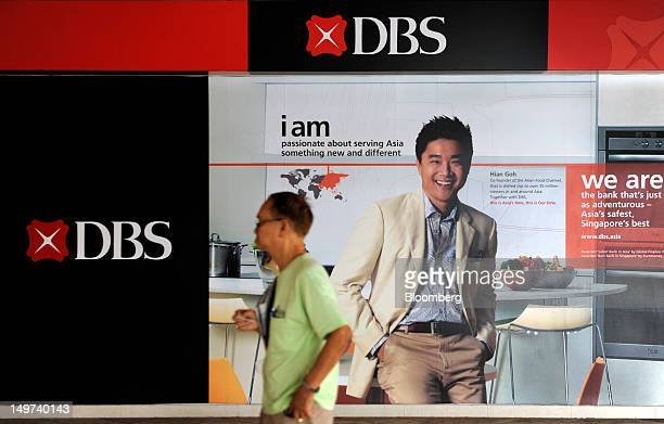 A pedestrian walks past a DBS Group Holdings Ltd advertisement displayed in a public housing estate in Singapore on Friday Aug 3 2012 DBS Southeast...