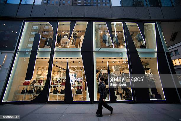 A pedestrian walks past a Donna Karan Co DKNY store on Madison Avenue in New York US on Tuesday April 8 2014 Consumer Comfort figures are scheduled...