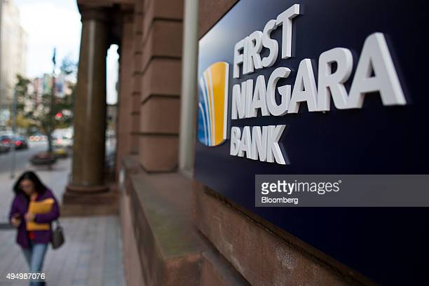A pedestrian walks past a First Niagara Financial Group Inc branch in Rochester New York US on Friday Oct 30 2015 KeyCorp Ohio's secondlargest bank...