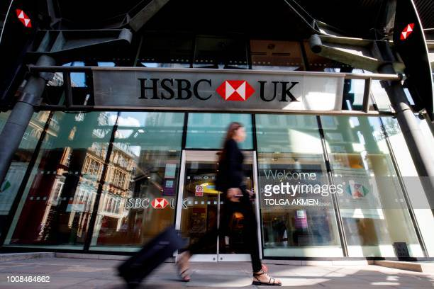 A pedestrian walks past a HSBC UK bank branch in central London on July 31 2018 HSBC will publish their halfyear results on August 6