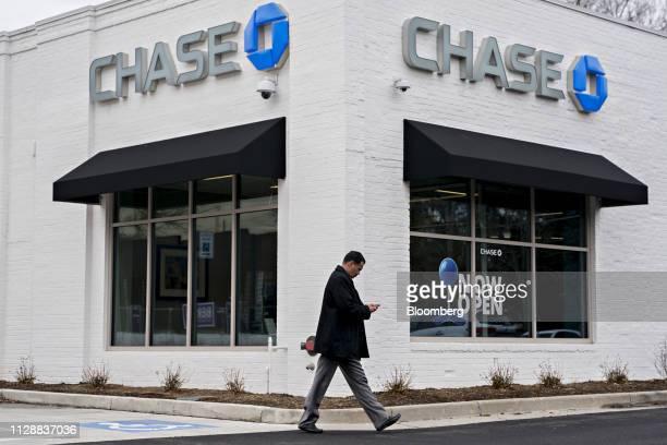 Pedestrian walks past a JPMorgan Chase & Co. Bank branch in the Clarendon neighborhood of Arlington, Virginia, U.S., on Friday, Feb. 22, 2019. In the...
