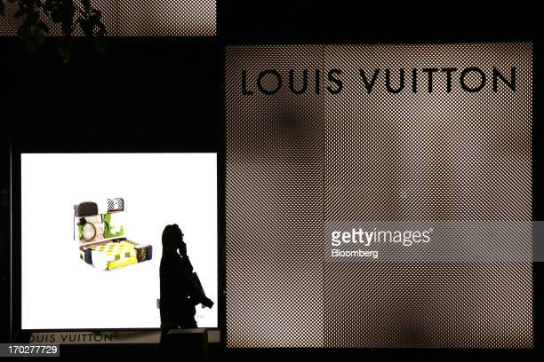 A pedestrian walks past a Louis Vuitton store operated by LVMH Moet Hennessy Louis Vuitton SA in Sapporo Hokkaido Prefecture Japan on Sunday June 9...