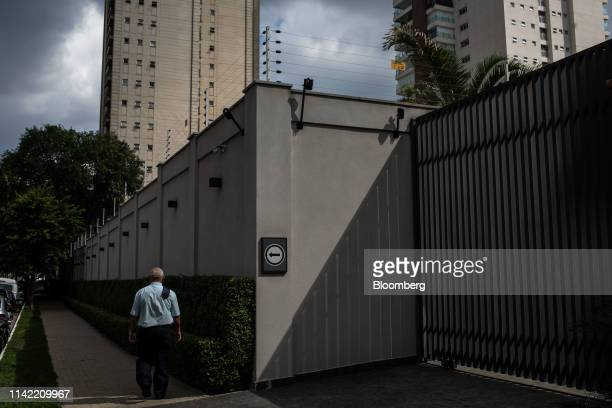 Pedestrian walks past a luxury apartment complex in the Vila Nova Conceicao neighborhood of Sao Paulo, on Monday, May 6, 2019. The luxury...