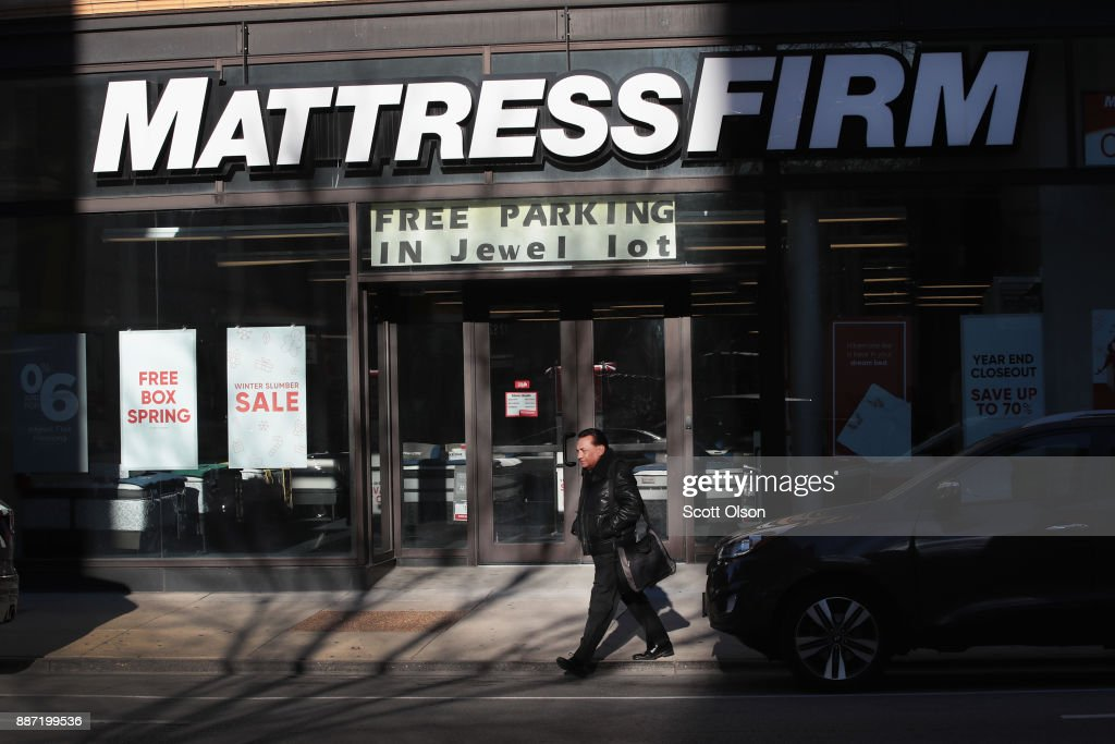 A pedestrian walks past a Mattress Firm store on December 6, 2017 in Chicago, Illinois. Steinhoff International Holdings N.V., which is the parent company of Mattress Firm, saw its stock value plummet more than 60 percent today after the resignation of CEO Markus Jooste and an announcement from the company that it was launching an investigation into accounting irregularities.