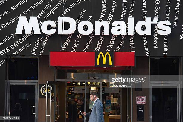 A pedestrian walks past a McDonald's Corp restaurant in New York US on Thursday Oct 22 2015 McDonalds Corp shares soared the most in almost seven...