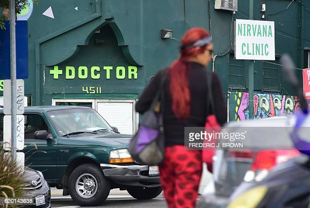 A pedestrian walks past a medical marijuana dispensary in Hollywood California on November 1 2016 ahead of next week's general elections where...