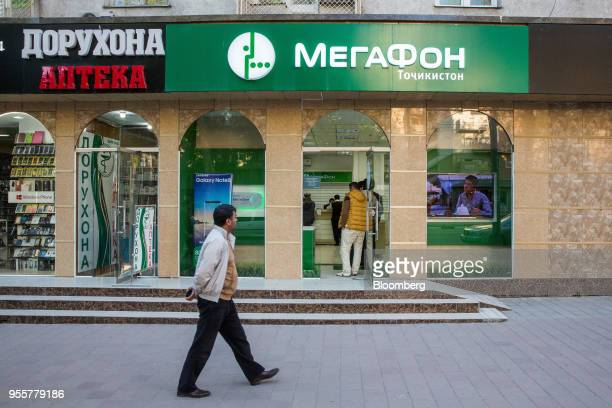 A pedestrian walks past a MegaFon PJSC mobile store in Dushanbe Tajikistan on Saturday April 21 2018 Flung into independence after the Soviet Union...