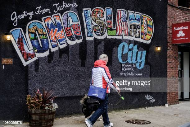 A pedestrian walks past a mural in the Long Island City neighborhood in the Queens borough of New York US on Friday Nov 9 2018 As reports emerged...