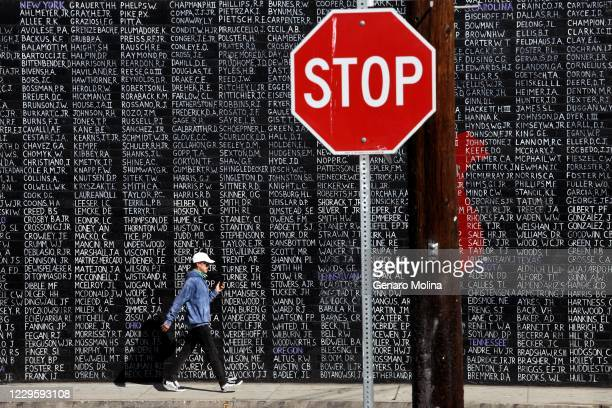 DAY A pedestrian walks past a mural that features the names of some of the 2273 Vietnam veterans that are still MIA from the conflict on Veterans Day...