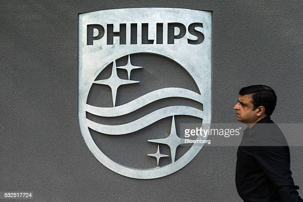 A pedestrian walks past a Philips logo displayed outside the Royal Phillips NV APAC Center in Singapore on May 19 2016 The new Philips Toa Payoh...
