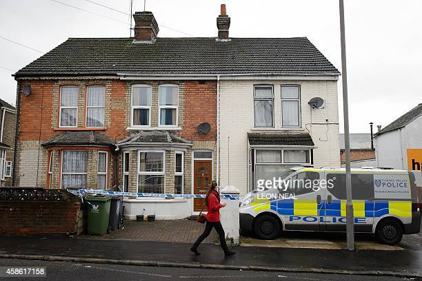 A pedestrian walks past a residential address marked off by police tape in High Wycombe Buckinghamshire north west of London on November 8 in...