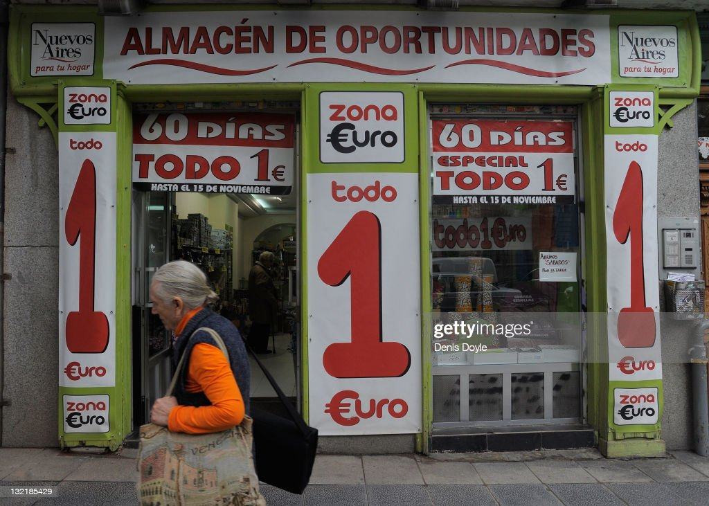 A pedestrian walks past a shop selling all goods for one euro on November 10, 2011 in Madrid, Spain. The current Eurozone debt crisis has left Spain with crippling economic problems. Mounting debts, record unemployment figures and the recent credit rating downgrade is leaving the country facing further economic stagnation. The people of Spain are preparing to go to the polls for a general election which will be held on November 20, 2011.