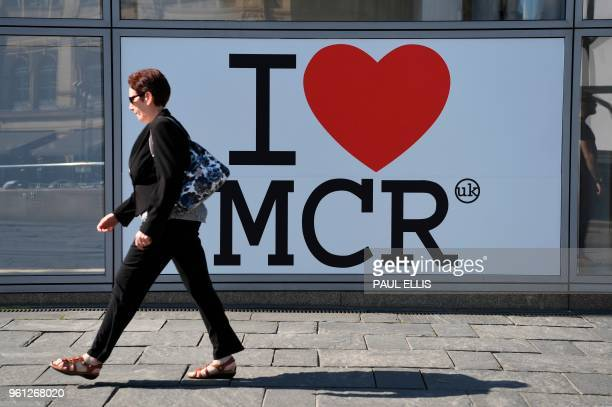 Pedestrian walks past a sign of support for Manchester set up in the wake of the Manchester Arena bombing in central Manchester on May 22 the one...
