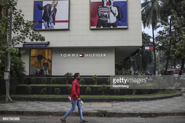 A pedestrian walks past a Tommy Hilfiger Corp store in Mumbai India on Friday Dec 15 2017 India's inflation surged past the central bank's target...