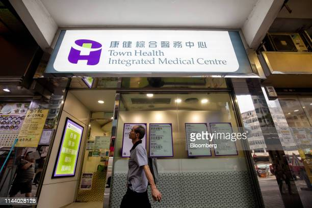 A pedestrian walks past a Town Health International Medical Group Ltd clinic in Hong Kong China on Monday May 13 2019 Cho Kwaichee founder of Town...